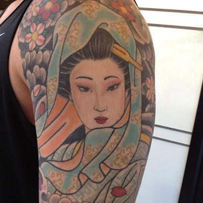 tatuagem de Gueixa no braço