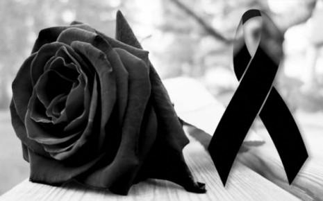 laço de luto e rosa negra